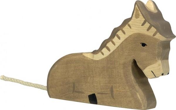 Holztiger Esel liegend